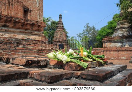 Incense Candle And White Lotus For Pray On Ancient Brick Wall Temple