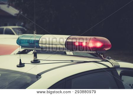 Close Up Of A Swithched Rotating Beacon Of A Police Car. The Top Of The Police Patrol Car With Flash