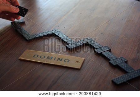 Hand To Move Piece Of Domino To Win In  Game