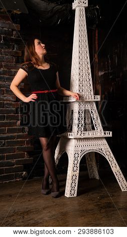 Girl In Green Outfit And Long Hair Sitting At The Trocadero Rooftop And Looking At The Eiffel Tower
