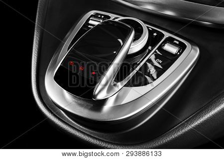 Media And Navigation Control Buttons Of A Modern Car. Car Interior Details. Brown Leather Interior W