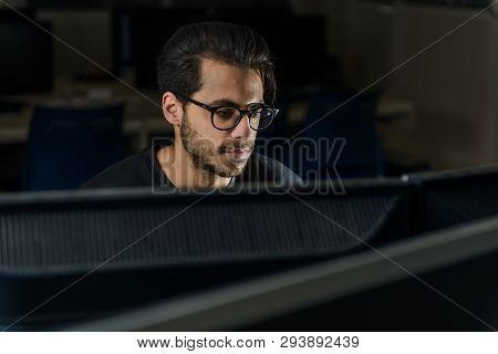 View Over A Screen Of The Face Of A Young Computer Science Student Working With The Computer In Cace
