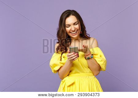 Laughing Young Woman In Yellow Summer Dress Using Mobile Phone, Typing Sms Message Isolated On Paste
