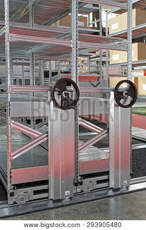 Hand Crank Movable Metal Shelving System In Storage Room