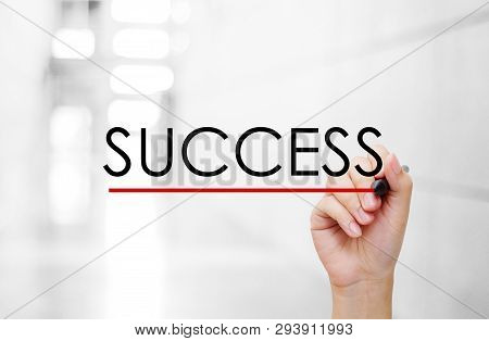 Hand Holding Pen And Success Word On Blur Background, Success In Business Concept