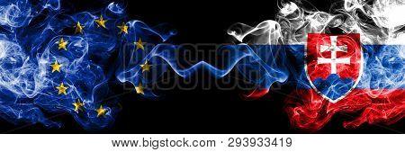 European Union Vs Slovakia, Slovakian Smoke Flags Placed Side By Side. Thick Colored Silky Smoke Fla