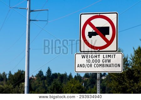No Trucks Sign Weight Limit 10,000 Gvw Sign On A Post