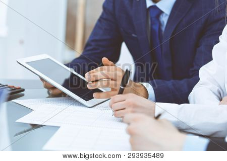 Bookkeepers Team Or Financial Inspectors  Making Report, Calculating And Checking Balance. Tax Servi