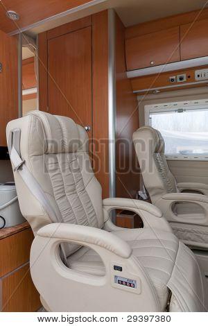 Car seats inside of  caravan