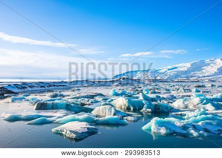 Icebergs In Jokulsarlon Glacier Lagoon In South Iceland With Vatnajokull Glacier In The Background