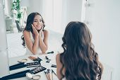 Portrait of her she nice-looking sweet tender gentle attractive lovely lovable fascinating charming cute feminine cheerful groomed wavy-haired lady looking at mirror in light white interior room poster