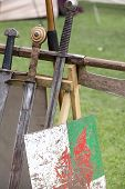 Medievil weaponry on display at historical reenactment poster
