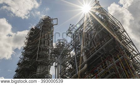 Petrochemical Refinery Plant. Industrial Towers At Oil Refinery. Oil Refinery Twilight On Classic Bl