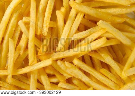 French Fried Fries Close-up. Background, Potato Chips.