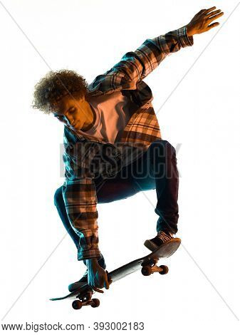 one caucasian young man skateboarder Skateboarding in studio silhouette shadow isolated on white background