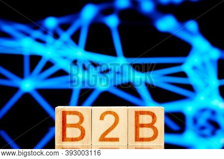 B2b. Wooden Cubes With The Inscription B2b On A Distributed Network Background