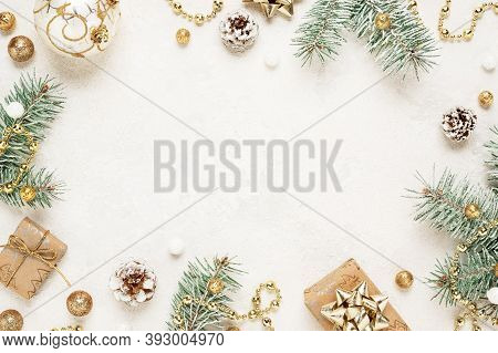 Christmas Mood Frame Of Gifts, Green Spruce, Gold Christmas Decorations On White Background. Copy Sp