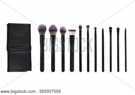 Professional Set Of Makeup Brushes In Different Sizes Isolated On A White Background. Case For Brush