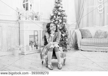 Making Wish. Waiting For Santa Claus. Adorable Girl Making Wish Near Christmas Tree Decorated Interi