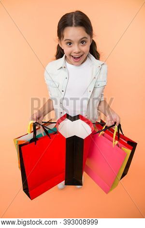 Check It Out. Child Cute Fashionista Shopping. Kid Girl Happy Smiling Face Carries Bunch Packages Ye
