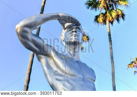 Newport Beach, California - July 25, 2020: The Ben Carlson Memorial Statue, A 9-foot-tall Stainless-