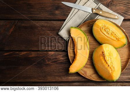 Tasty Fresh Cut Melon On Wooden Table, Flat Lay. Space For Text