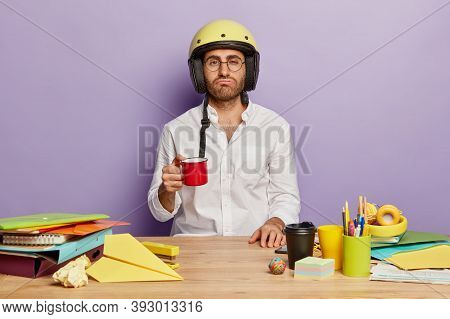 Overworked Sleepy Employer Works Late, Drinks Fresh Coffee, Has Tired Expression, Wears Yellow Helme