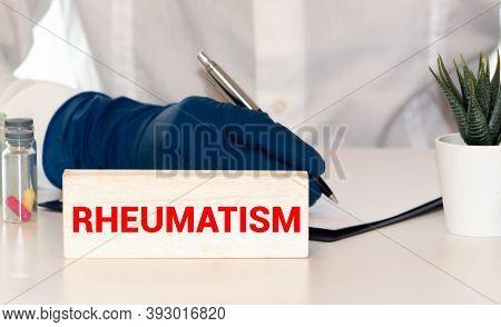 Rheumatism Word From Wooden Blocks On Desk.