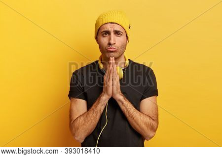 Please Forgive Me. Miserable Sad Man Keeps Palms Together, Begs For Favour, Asks For Help, Wears Yel