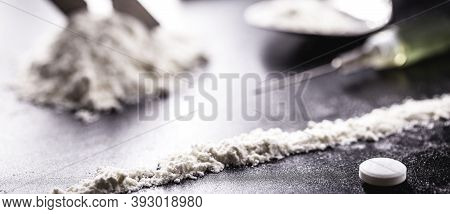 Cocaine And Heroin On Dark Wooden Table, Concept Of Addiction And Chemical Dependency, Illegal Drugs