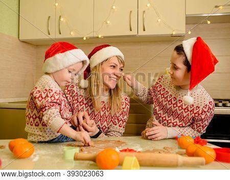 Funny Kids Are Preparing The Dough, Baking Gingerbread Cookies In The Kitchen On Winter Day. Funny C