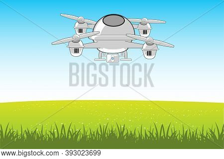 Flying Machine Quadcopter In Sky On Green Glade