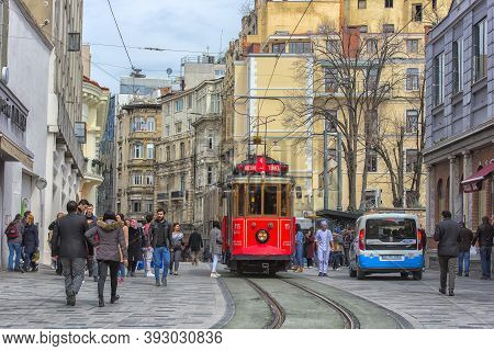 Retro Tram Moves Along A Busy Istiklal Street In Istambul.