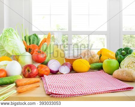 Selective Focus On Cloth/set Of Variety Vegetable With Copy Space On Kitchen Counter Bar With Window