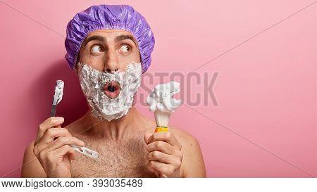 Surprised Man Shaves Beard, Holds Shaving Tools, Applies Foam With Brush, Uses Razor Blade, Wears Sh