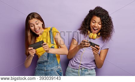 Carefree Outgoing Teenage Gamers Play Online Games, Win First Place Or Gain Highest Score, Tilt From