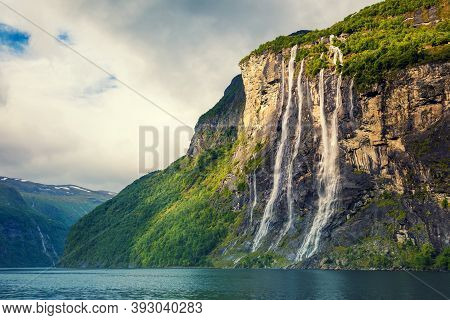Geiranger Fjord. Seven Sisters Waterfall, Norway. Mountain Landscape With Cloudy Sky. Beautiful Natu