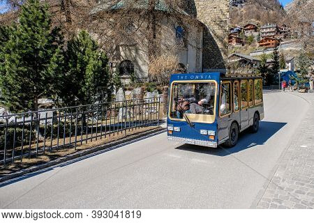 Zermatt, Switzerland - March 26, 2017: A Taxi On The Road At The Old Village City Of Zermatt In 26 M