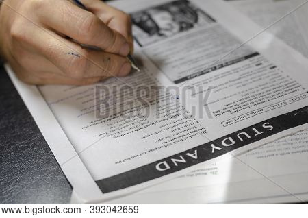 Adult Man Takes An English Test. Partially Completed Multiple Choice English Test. Distance Learning