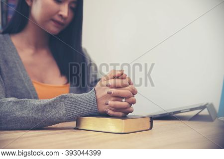 Prayer And Bible Concept.asian Female Praying, Hope For Peace And Free From Coronavirus, Hand In Han