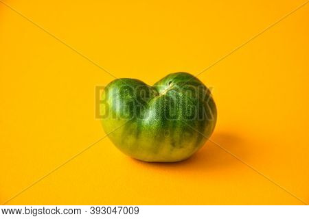 Trendy Ugly Organic Vegetables. Green Tomato On Yellow Background. Cooking Ugly Food Concept. Top Vi