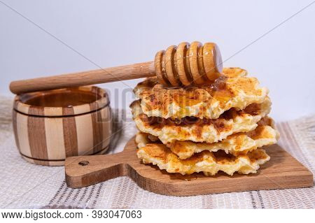 Waffles With Hot Maple Syrup. Honey Pouring On A Fresh Waffles.