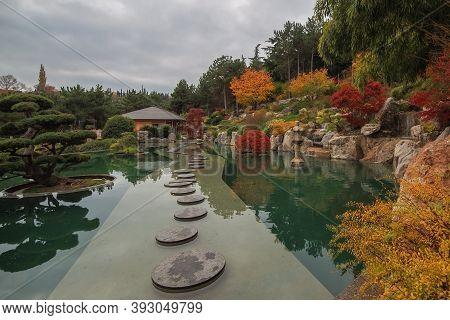 Yalta, Crimea, Russia - November 24, 2018: Japanese Garden With Bonsai Tree And Tea House In Crimea,