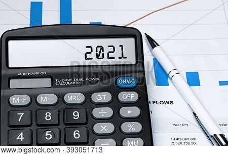 Calculator With The Word 2021 On The Display. Money, Finance And Business Concept