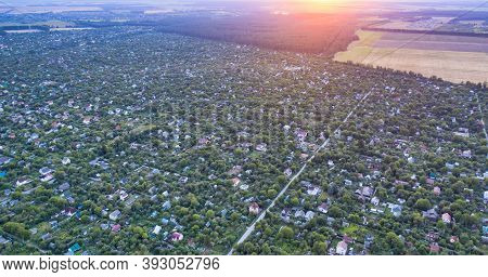 View Of The Suburban Village On The Outskirts Of The City From A Height At Sunset. Plenty Of Private
