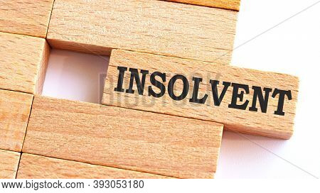 Insolvent Word Written On Wood Block. Insolvent Text On Table, Concept.business Photo Text Make Some