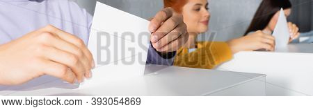 Electors Inserting Ballots Into Polling Boxes On Blurred Background, Banner