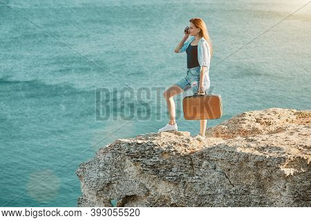 Young Woman On Holiday Taking Picture To Memory. Lady With Vintage Suitcase. Summer Time And Vacatio