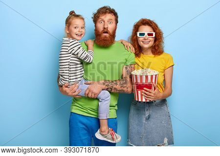 Family, Leisure, Entertainment Concept. Scared Father, Smiling Mother And Glad Daughter Watch Thrill