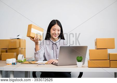 Young Asian Woman Business Owner With Many Parcel Boxes On The Table Happy Online Sales Job, Use You